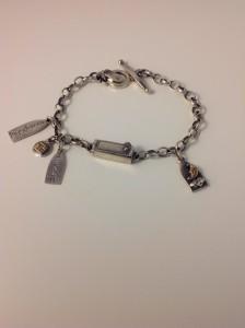 'Perchance to Dream' silver charm bracelet.