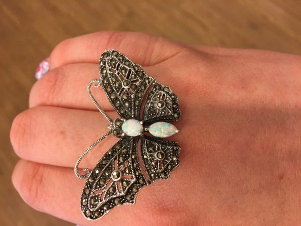 A Marcasite and Opalite Butterfly Brooch shown on hand