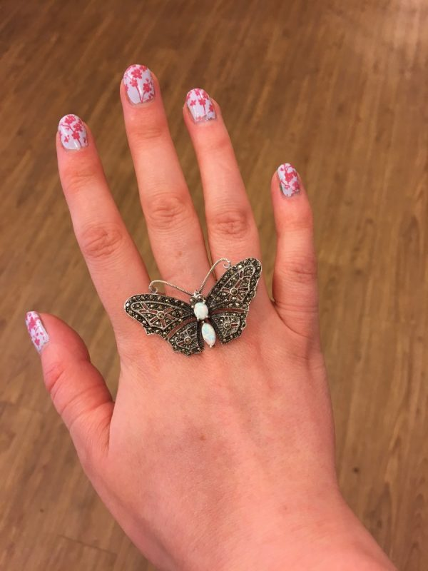 A Marcasite and Opalite Butterfly Brooch shown on LJ's hand