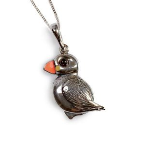 a silver and enamel puffin pendant