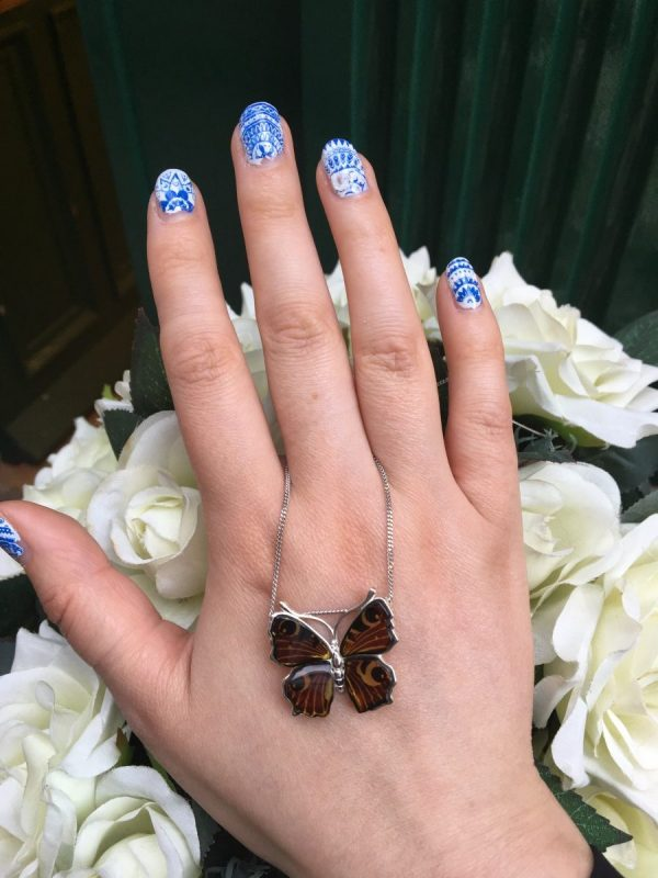 peacock butterfly on hand