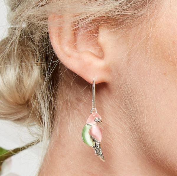parrot earrings on ear