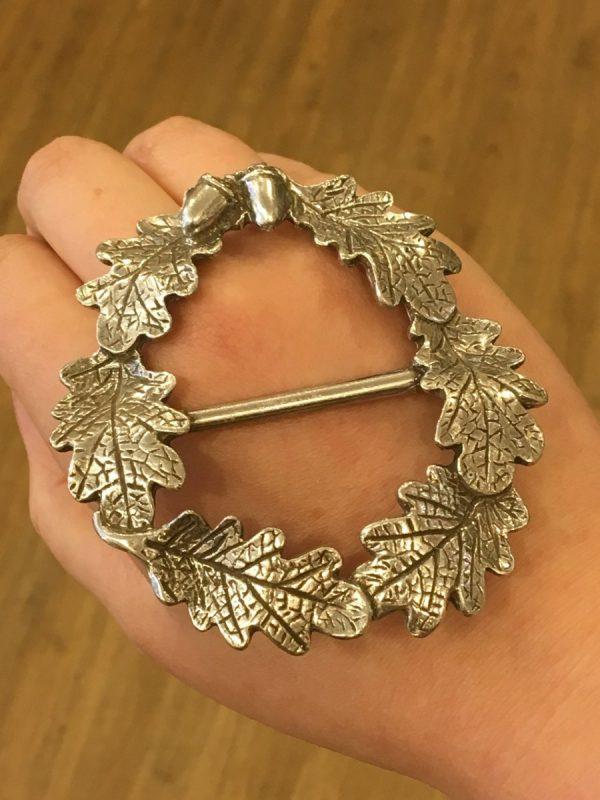 oak leaf wreath scarf ring on hand