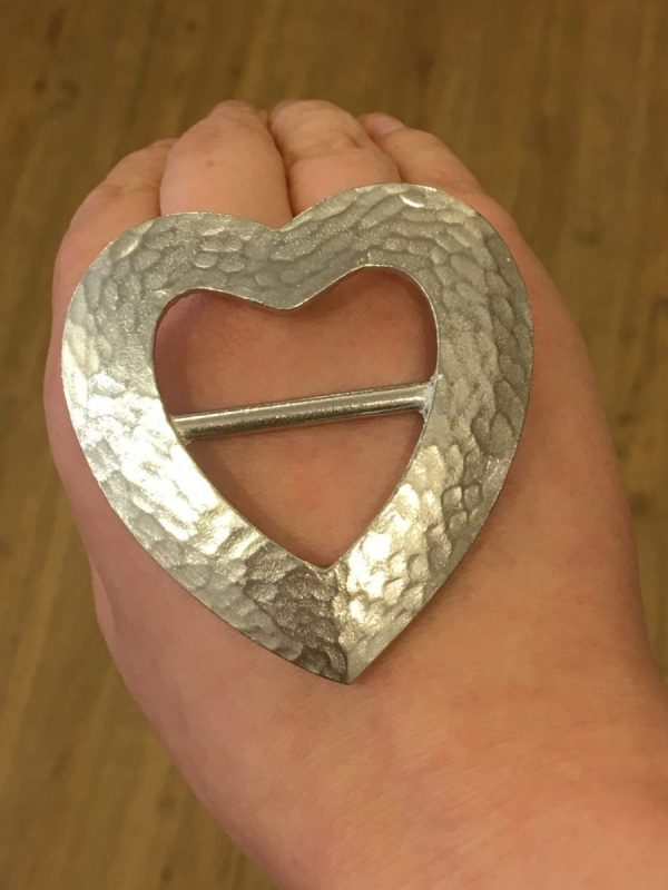 hammered heart scarf ring on hand