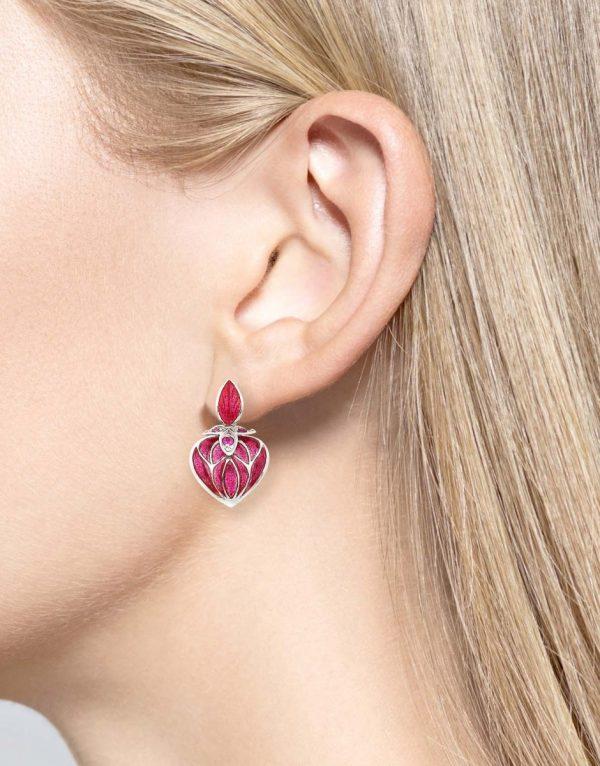 ruby enamel heart earrings on model