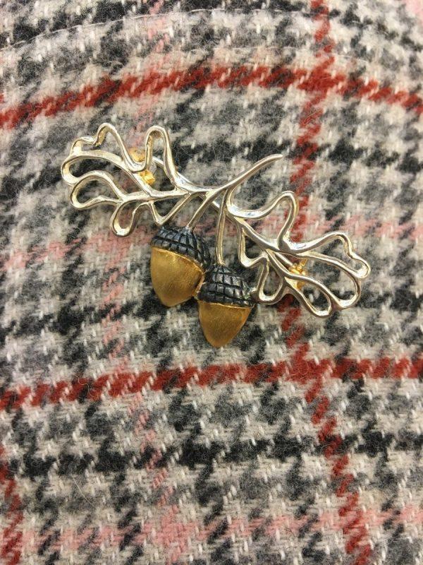 golden acorns brooch on tweed