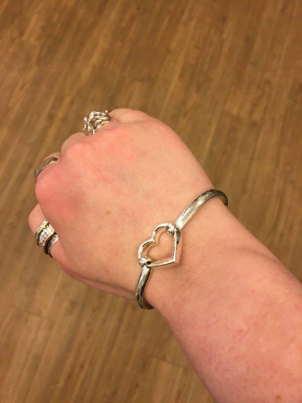 silver bangle on wrist
