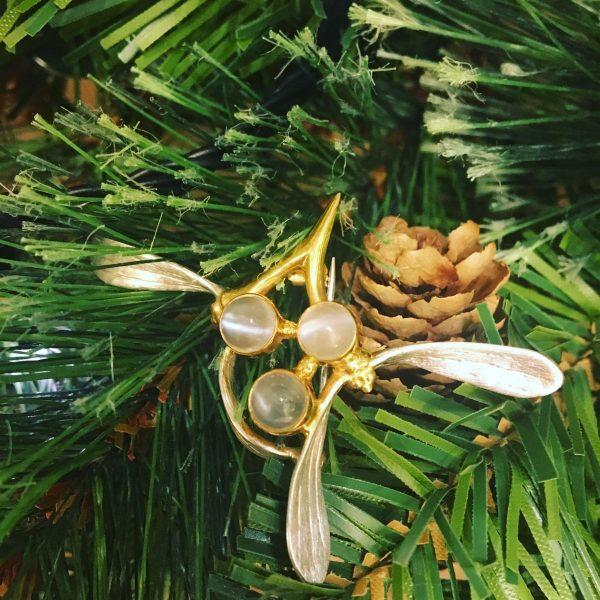 mistletoe brooch on greenery
