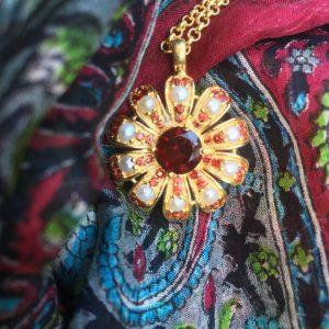 Garnet Sunburst Pendant on scarf
