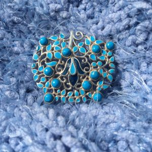 Turquoise and Enamel Brooch on soft blue