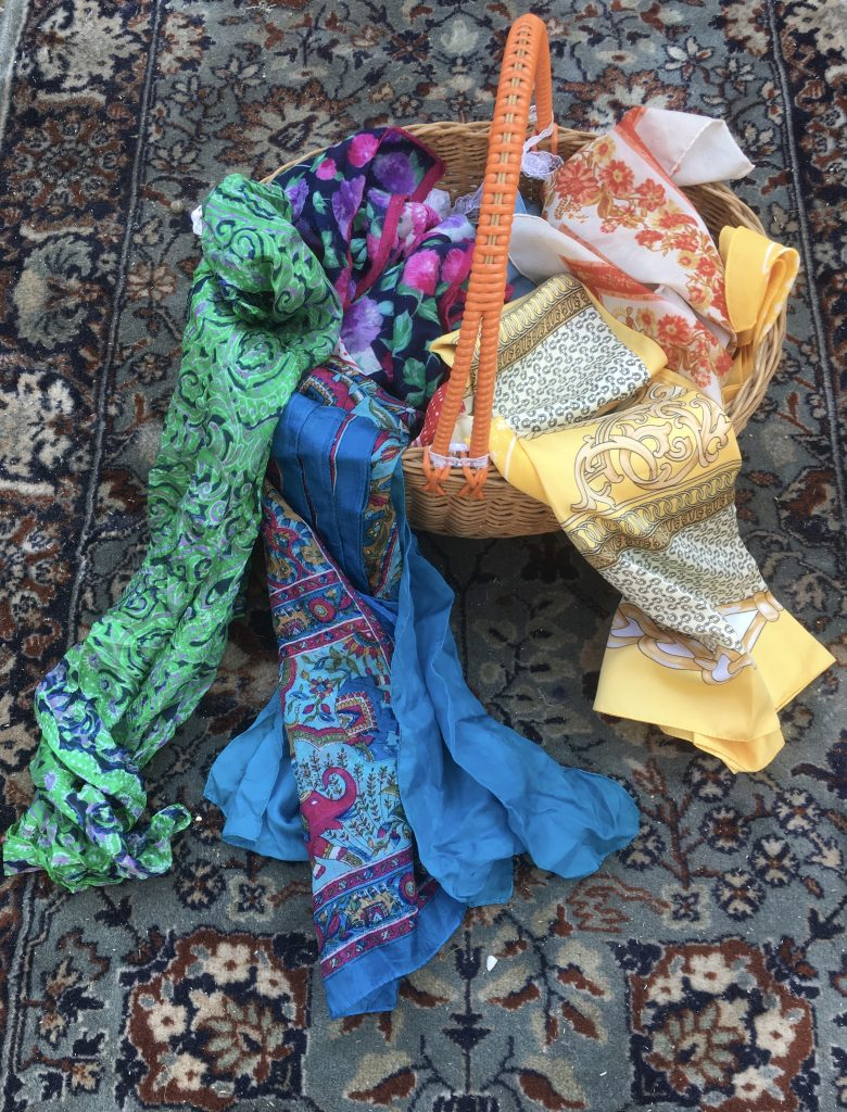 A basket of vintage scarves