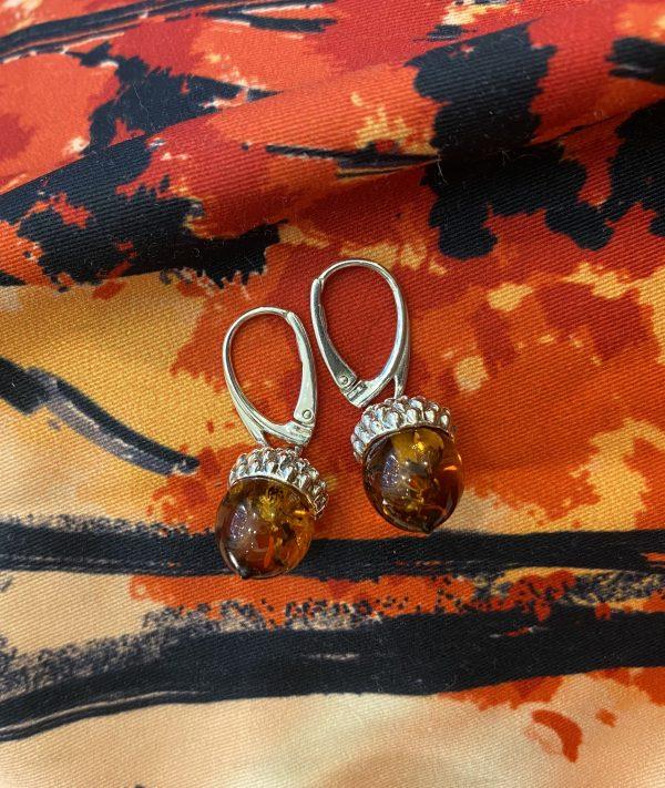 amber acorn earrings on burnt orange