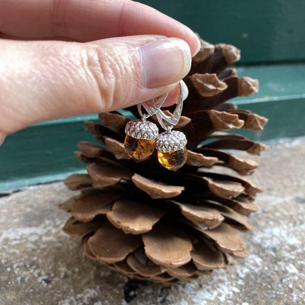 amber acorn earrings outside