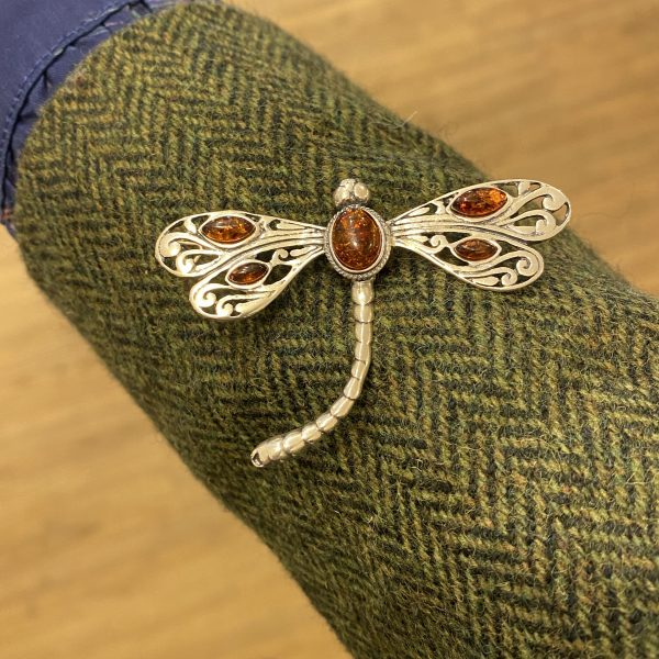 amber dragonfly brooch on sleeve