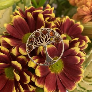 amber tree of life brooch on flowers