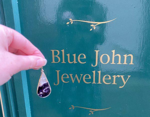 blue john gold next to wording