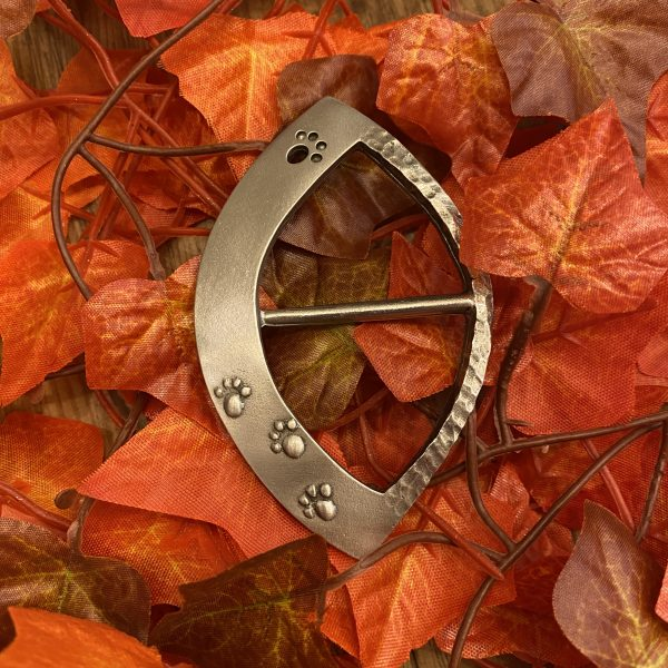 paw print scarf ring on Autumn leaves