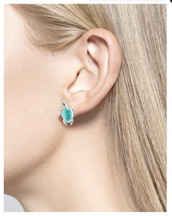 enamel turtle earrings on ear