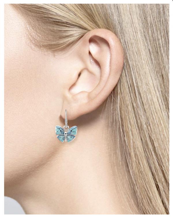 enamel butterfly drop earrings on model